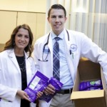 UB pharmacy students Kelsey Violanti (left) and Lukas Brightman distributed 1,000 pouches on Aug. 6 at New York State Sen. Mike Ranzenhofer's Family Health Fair. Photo: UB Pharmacy
